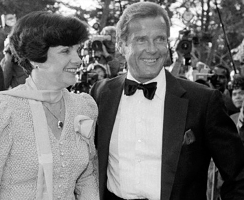 (left) Mayor Dianne Feinstein with Roger Moore at the World Premiere of A View To A Kill held at the Palace of Fine Arts, San Francisco on May 22, 1985. (right) Moore signs autographs for the waiting fans as EON Productions Director of Marketing Jerry Juroe tries to move him on.