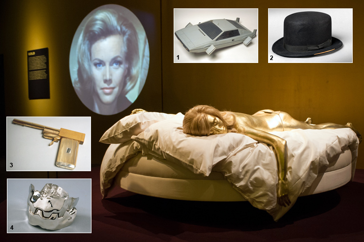Life-size replica of Jill Masterson from Goldfinger (1964) and James Bond props and gadgets on display at Designing 007: 50 Years of Bond Style