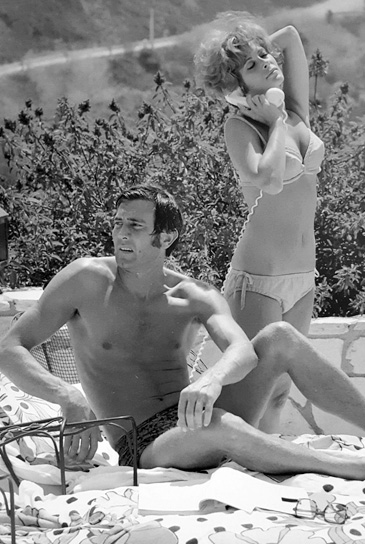 George Lazenby and Jill  St. John in Las Vegas 1969 - Photograph by Terry O'Neill